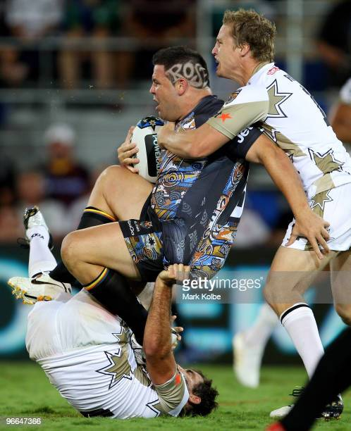 George Rose of the Indigenous All Stars is tackled by Cameron Smith and Brett Finch of the NRL All Stars during the Indigenous All Stars and the NRL...
