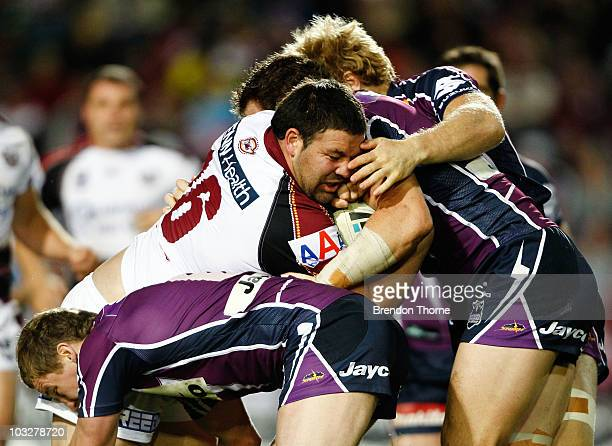 George Rose of the Sea eagles is tackled by the Storm defence during the round 22 NRL match between the Manly Sea Eagles and the Melbourne Storm at...