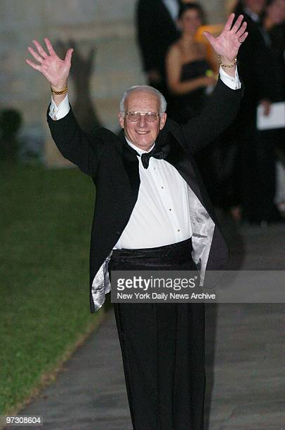 George Ross Donald Trump's righthand man on the hit television show The Apprentice waves as he enters the Episcopal Church of BethesdabytheSea in...