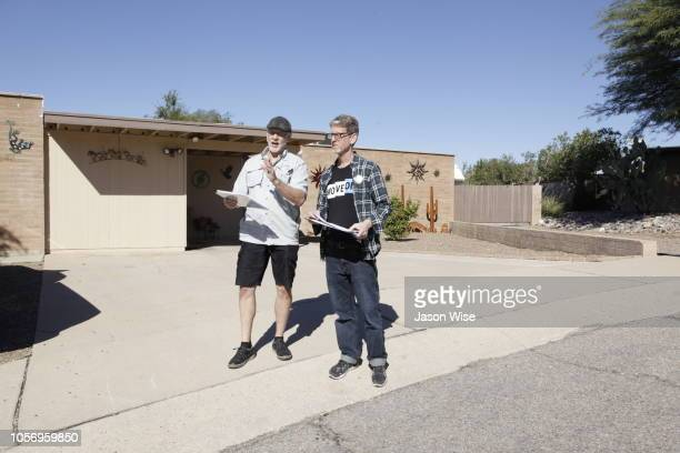 George Rowe and David Nevins of MoveOn canvass for Ann Kirkpatrick on November 3 2018 in Tucson Arizona