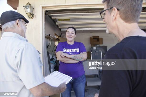 George Rowe and David Nevins of MoveOn speak with Ashley Lira while canvassing for Ann Kirkpatrick on November 3 2018 in Tucson Arizona