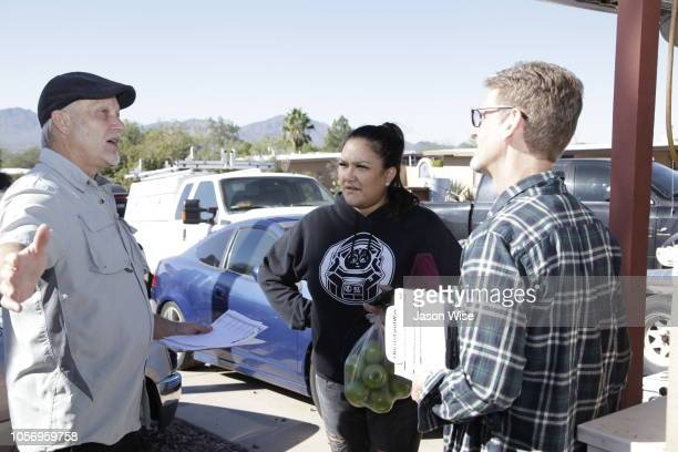 George Rowe and David Nevins of MoveOn speak with Melissa Leon while canvassing for Ann Kirkpatrick on November 3 2018 in Tucson Arizona