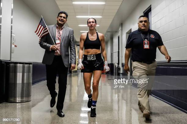 George Ruiz and Mikaela Mayer head back to the locker room at the Chesapeake Energy Arena on June 30 2018 in Oklahoma City Oklahoma Mayer scored a...