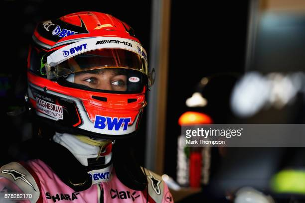 George Russell of Great Britain and Force India looks on in the garage during practice for the Abu Dhabi Formula One Grand Prix at Yas Marina Circuit...
