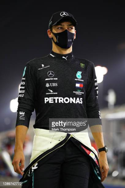 George Russell of Great Britain and Mercedes GP looks on before the F1 Grand Prix of Sakhir at Bahrain International Circuit on December 06, 2020 in...