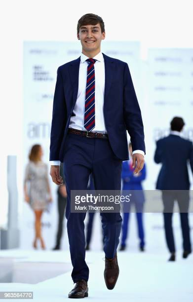 George Russell of Great Britain and Mercedes walks the catwalk at the Amber Lounge Fashion show during previews ahead of the Monaco Formula One Grand...