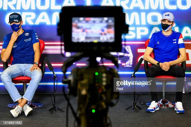 George Russell of Great Britain and Williams and Esteban Ocon of France and Alpine F1 Team talk in the Drivers Press Conference during previews ahead...