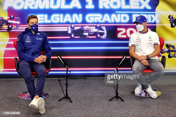 George Russell of Great Britain and Williams and Valtteri Bottas of Finland and Mercedes GP talk in the Drivers Press Conference during previews...