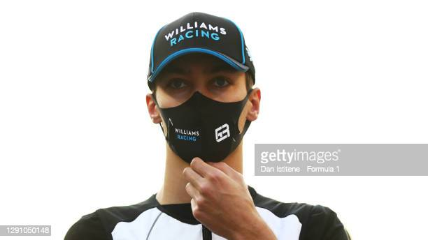 George Russell of Great Britain and Williams looks on from the grid prior to during the F1 Grand Prix of Abu Dhabi at Yas Marina Circuit on December...
