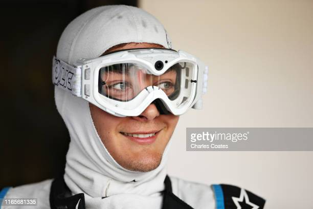 George Russell of Great Britain and Williams prepares to drive in the garage during practice for the F1 Grand Prix of Hungary at Hungaroring on...