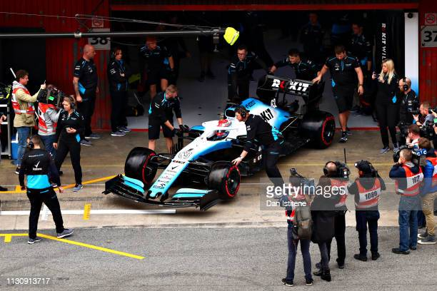 George Russell of Great Britain driving the Rokit Williams Racing FW42 Mercedes is pushed back into the garage during day three of F1 Winter Testing...