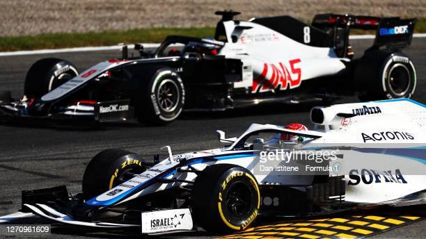 George Russell of Great Britain driving the Williams Racing FW43 Mercedes and Romain Grosjean of France driving the Haas F1 Team VF-20 Ferrari battle...