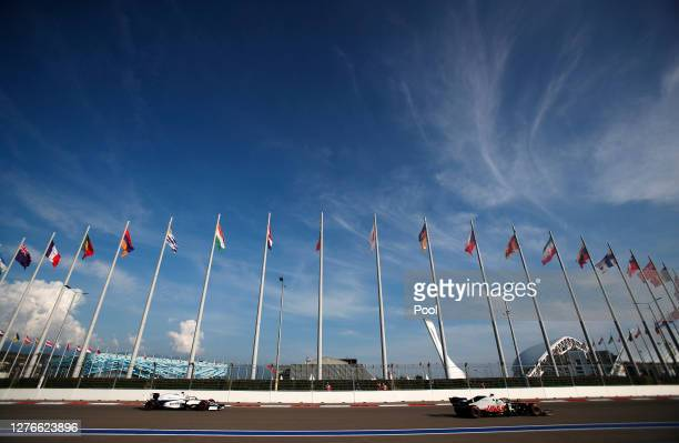 George Russell of Great Britain driving the Williams Racing FW43 Mercedes and Romain Grosjean of France driving the Haas F1 Team VF-20 Ferrari drove...