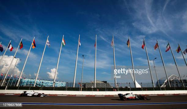 George Russell of Great Britain driving the Williams Racing FW43 Mercedes and Romain Grosjean of France driving the Haas F1 Team VF-20 Ferrari on...