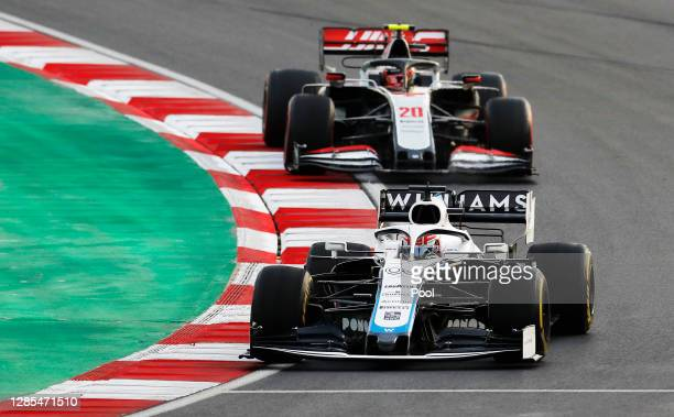 George Russell of Great Britain driving the Williams Racing FW43 Mercedes leads Kevin Magnussen of Denmark driving the Haas F1 Team VF-20 Ferrari on...