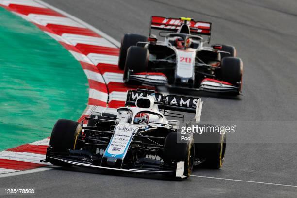George Russell of Great Britain driving the Williams Racing FW43 Mercedes leads Kevin Magnussen of Denmark driving the Haas F1 Team VF-20 Ferrari...