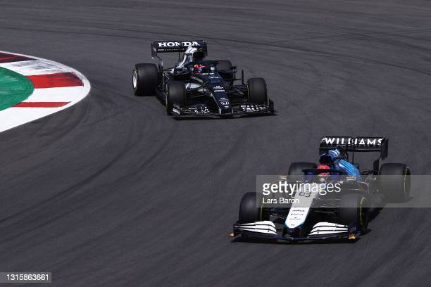 George Russell of Great Britain driving the Williams Racing FW43B Mercedes leads Yuki Tsunoda of Japan driving the Scuderia AlphaTauri AT02 Honda on...