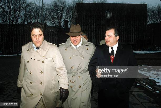 George Santangelo John Gotti's attorney Bruce Cutler and Gene Gotti leave the Brooklyn Federal Courthouse in New York March 13 1987 after Gene is...