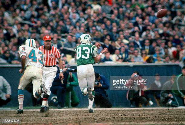 George Sauer of the New York Jets chases after a pass defended by Bob Neff of the Miami Dolphins during an NFL football game circa 1967 at Shea...