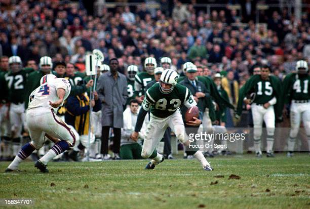 George Sauer of the New York Jets looks to pus a move on a Buffalo Bills defender during an NFL football game circa 1967 at Shea Stadium in the...