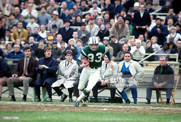 George Sauer of the New York Jets runs up field with the ball during an NFL football game circa 1969 at Shea Stadium in the Queens borough of New...