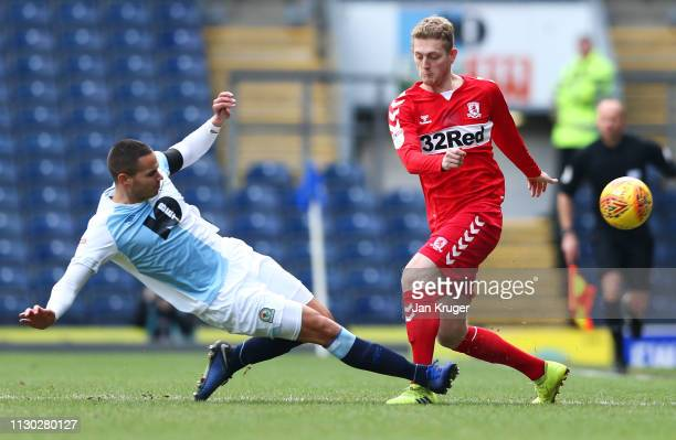 George Saville of Middlesbrough is challenged by Jack Rodwell of Blackburn Rovers during the Sky Bet Championship match between Blackburn Rovers and...