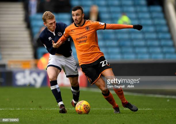 George Saville of Millwall and Romain Saiss of Wolverhampton Wanderers during the Sky Bet Championship match between Millwall and Wolverhampton at...