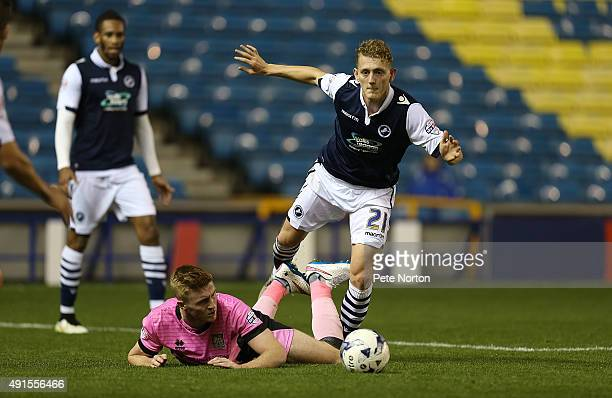 George Saville of Millwall contests the ball with Ryan Watson of Northampton Town during the Johnstone's Paint Trophy Second Round match between...