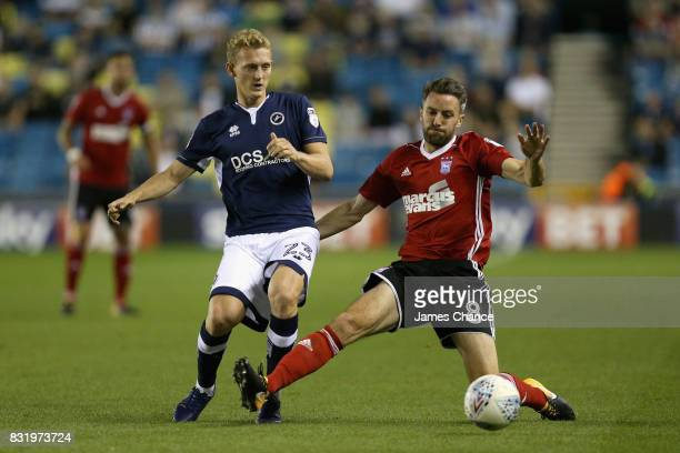 George Saville of Millwall takes the ball past Cole Skuse of Ipswich during the Sky Bet Championship match between Millwall and Ipswich Town at The...
