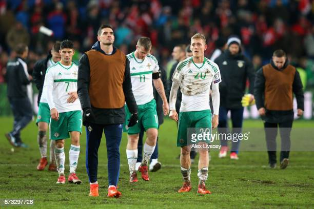 George Saville of Northern Ireland and team mates look dejected following the FIFA 2018 World Cup Qualifier PlayOff Second Leg between Switzerland...