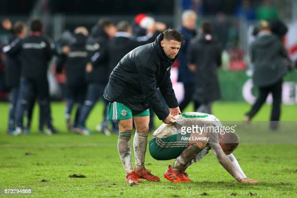 George Saville of Northern Ireland is consoled by Oliver Norwood of Northern Ireland following the FIFA 2018 World Cup Qualifier Play-Off: Second Leg...