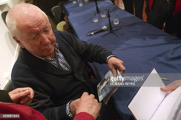 George Schindler autographs books during the launching of the book La Lista de Schindler Chileno written by Manuel Salazar Salvo on his life in...