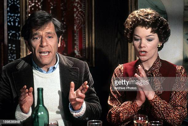 George Segal and Glenda Jackson both exposing their bottom teeth while speaking in a scene from the film 'Lost And Found', 1979.