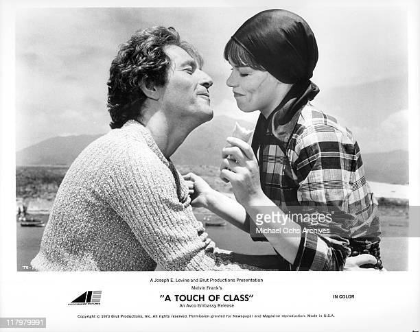 George Segal and Glenda Jackson share a moment in the Mediterranean sun in a scene from the film 'A Touch of Class', 1973.