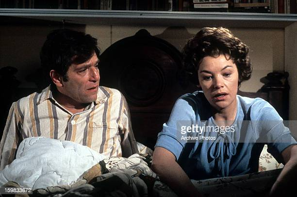 George Segal and Glenda Jackson sitting up in bed in a scene from the film 'Lost And Found', 1979.