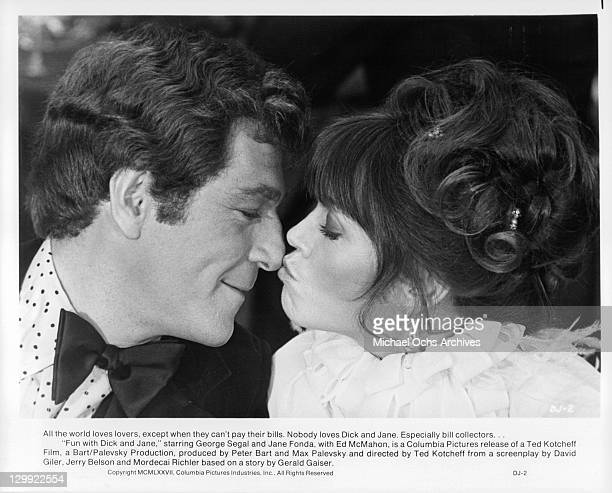 George Segal And Jane Fonda kiss in a scene from the film 'Fun with Dick and Jane', 1977.