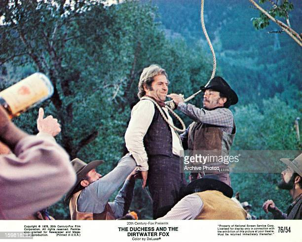 George Segal has a noose tied around his neck in a scene from the film 'The Duchess And The Dirtwater Fox', 1976.