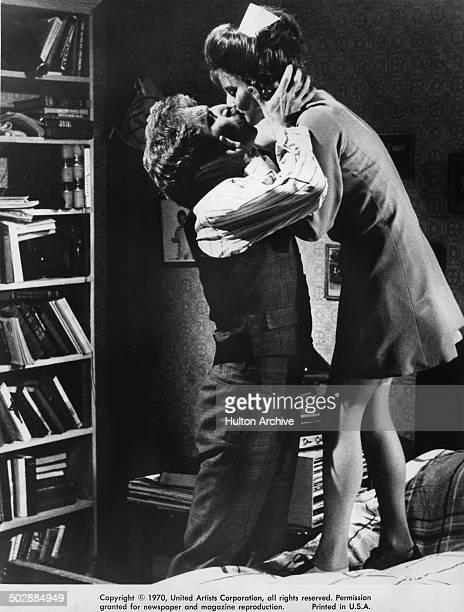 George Segal kisses Trish Van Devere in a scene from the United Artist movie Where's Poppa circa 1970