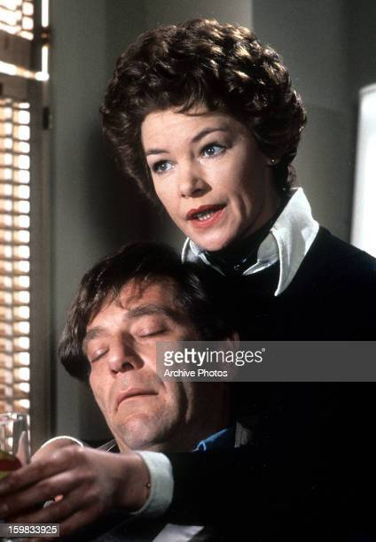 George Segal leaning on Glenda Jackson as his eyes are closed in a scene from the film 'Lost And Found', 1979.