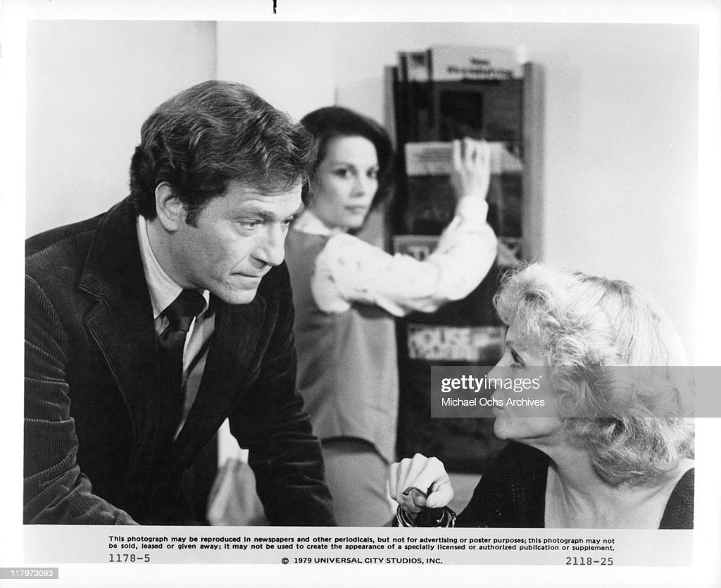 George Segal talks with Valerie Harper while Natalie Wood listens in the background in a scene from the film 'The Last Married Couple in America', 1980.