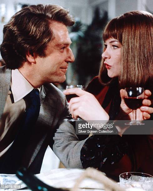 George Segal, US actor, and Glenda Jackson, British actress, drinking red wine in a publicity still issued for the film, 'A Touch of Class', 1973....