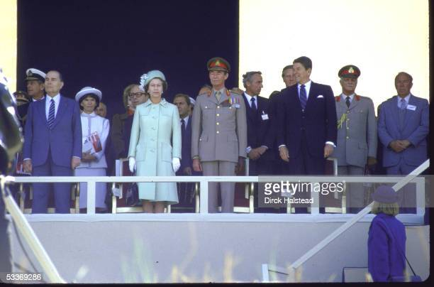 George Shultz unidentified Ronald Reagan Grand Duke Jean Queen Elizabeth II Francois Mitterrand and others during ceremonies on the 40th anniversary...