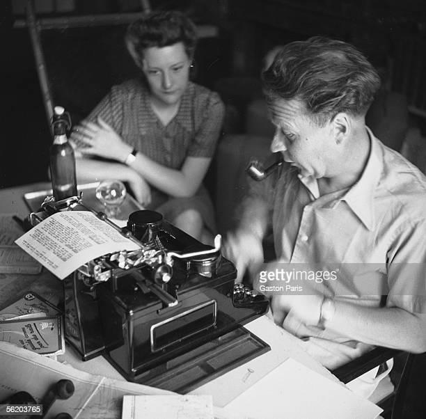 George Simenon with his typewriter. Castle of Terre-Neuve, Fontenay-le-Comte . 1942.