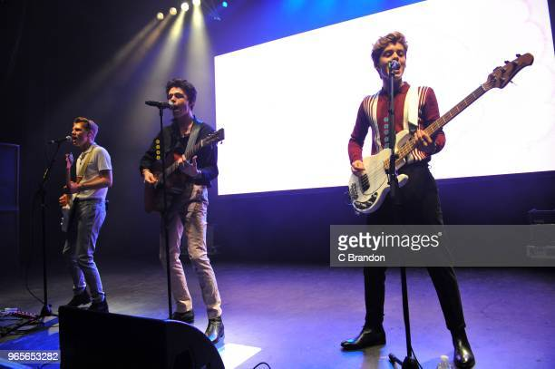 George Smith Blake Richardson and Reece Bibby of New Hope Club perform on stage at the O2 Shepherd's Bush Empire on June 1 2018 in London England