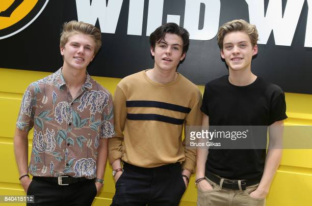 George Smith Blake Richardson and Reece Bibby of the band New Hope Club pose at a fan concert and meet greet at Buffalo Wild Wings Times Square on...