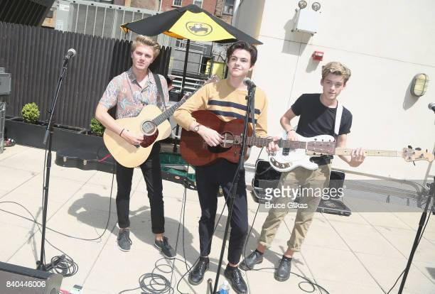 George Smith Blake Richardson and Reece Bibby of the band New Hope Club perform at a fan concert and meet greet at Buffalo Wild Wings Times Square on...