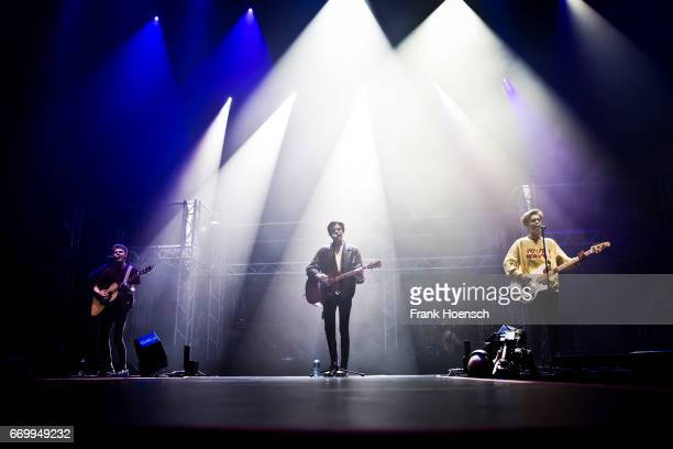 George Smith Blake Richardson and Reece Bibby of the British band New Hope Club perform live in support of Martina Stoessel during a concert at the...