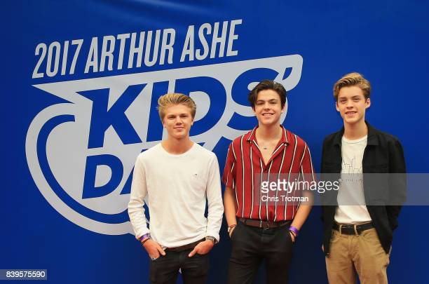 George Smith Blake Richardson and Reece Bibby of the group New Hope Club smile on the red carpet before the stadium show during Arthur Ashe Kids' Day...