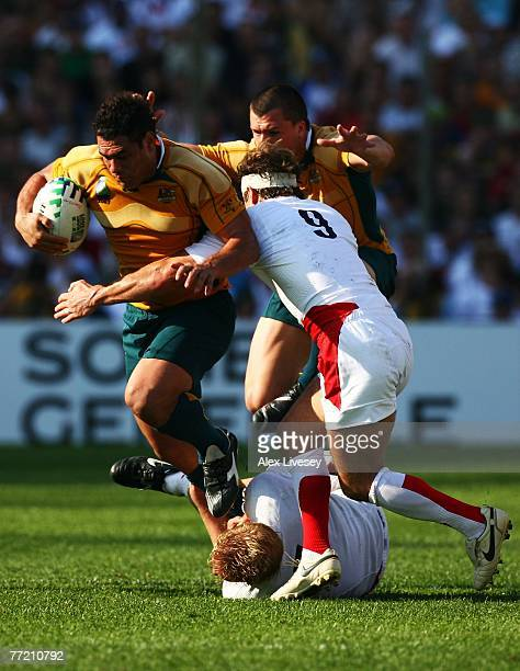 George Smith of Australia is tackled by Andy Gomarsall of England during the Quarter Final of the Rugby World Cup 2007 between Australia and England...