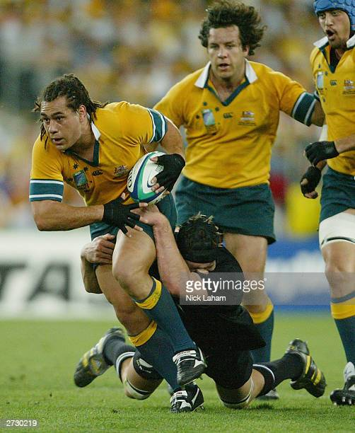 George Smith of Australia is tackled during the Rugby World Cup Semi-Final match between Australia and New Zealand at Telstra Stadium November 15,...